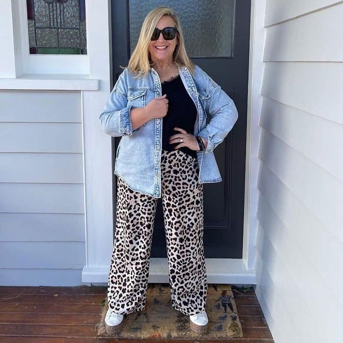 Palazzo pants outfits - Emma @sisterhoodofstylenz wears leopard print pants and denim jacket | 40plusstyle.com