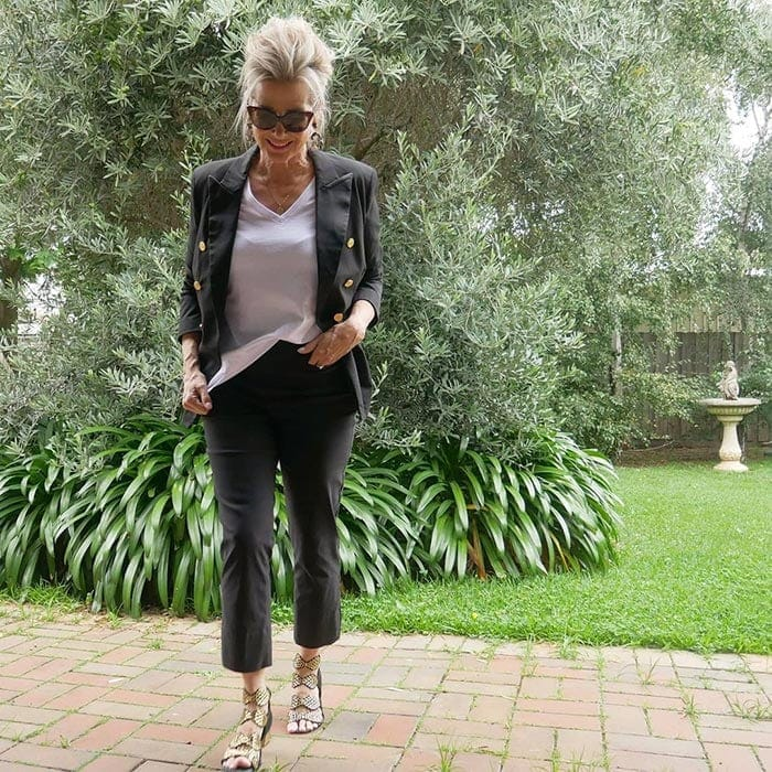Suzie in black pants and a double-breasted blazer | 40plusstyle.com