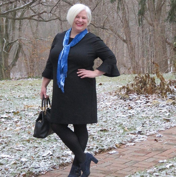 Julia wears a perfect little black dress for the apple shape | 40plusstyle.com
