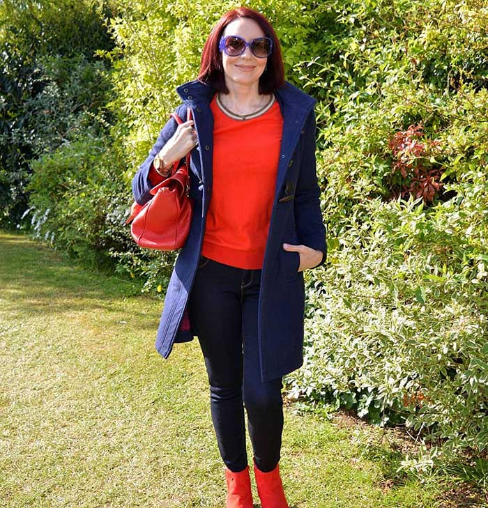 Emma wears a red sweater and booties | 40plusstyle.com