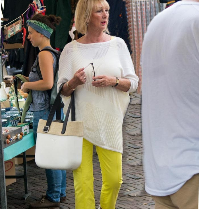 Asymmetric top with yellow pants | 40plusstyle.com