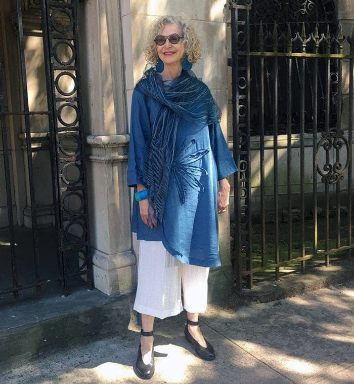 Dayle wears wide leg pants with her asymmetrical tunic | 40plusstyle.com