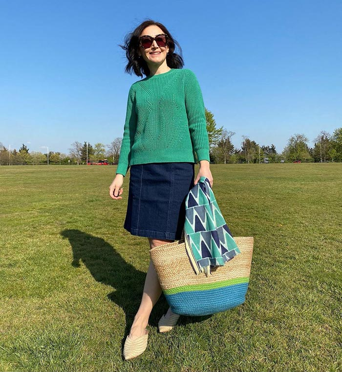Emms in a skirt and green sweater | 40plusstyle.com