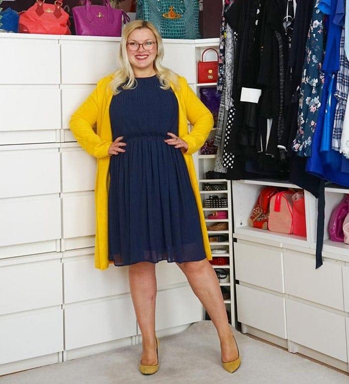 Katharina wearing a blouson dress with a long cardigan.