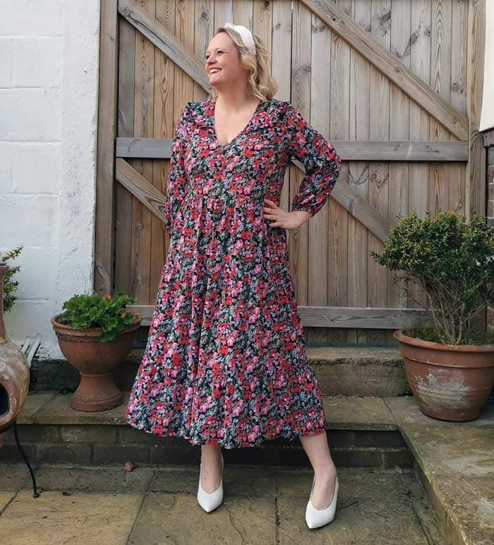 Caroline wearing an 80s-style floral dress | 40plusstyle.com