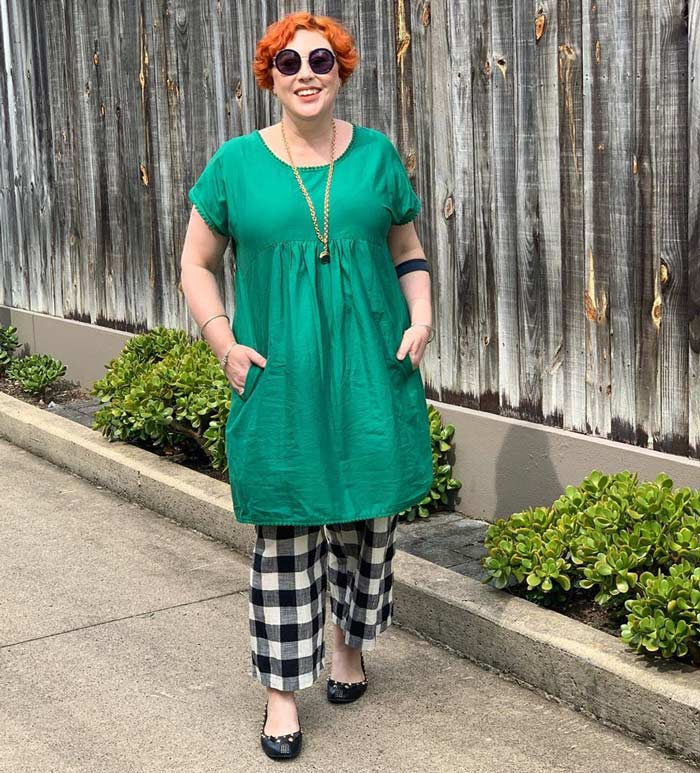 wearing a green dress over check pants | 40plusstyle.com