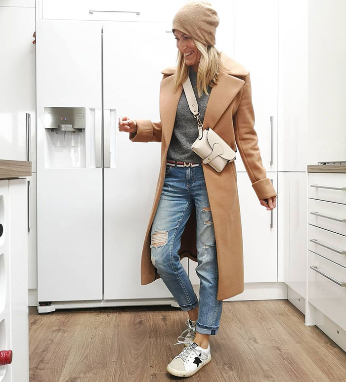 Abi wears a beige beanie to match her coat | 40plusstyle.com
