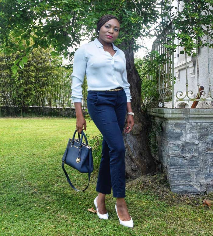 Joy wears a white shirt and black pants | 40plusstyle.com