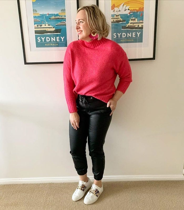 How to wear pink - Kylie wears a pink sweater and earrings | 40plusstyle.com