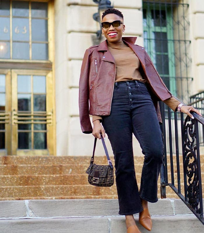 Psyche wearing a moto jacket and jeans | 40plusstyle.com