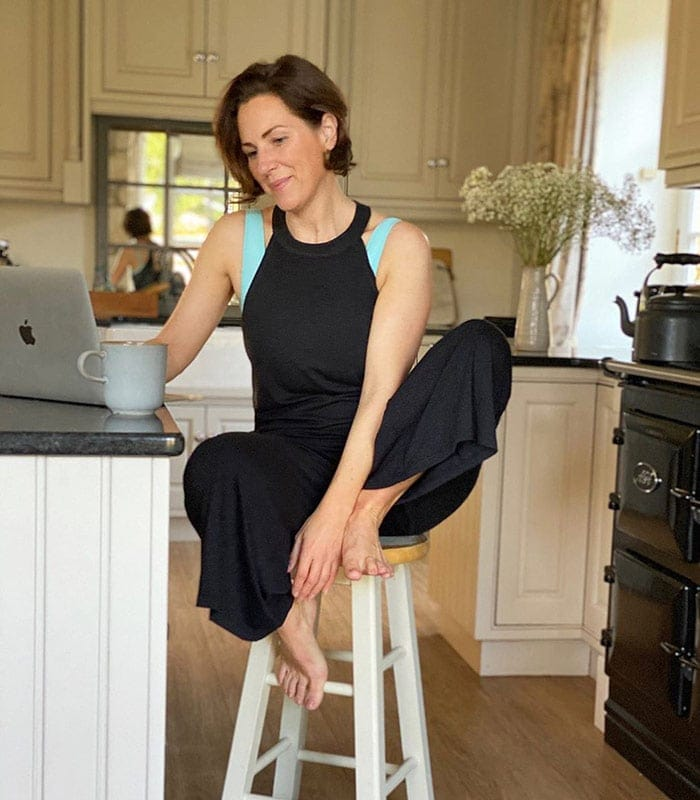 a loungewear jumpsuit worn with a sports bra   40plusstyle.com