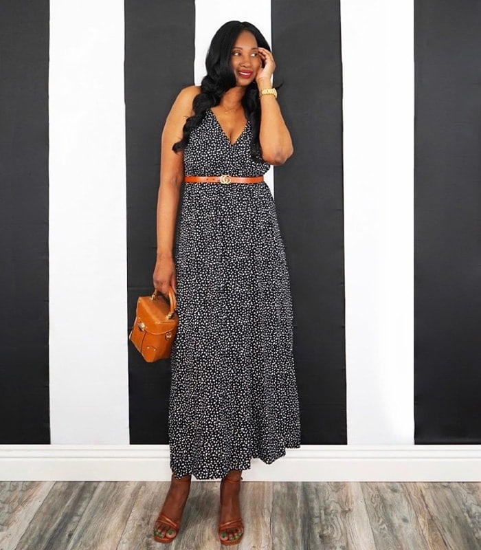 Tanasha wears a black maxi dress with tan accessories | 40plusstyle.com
