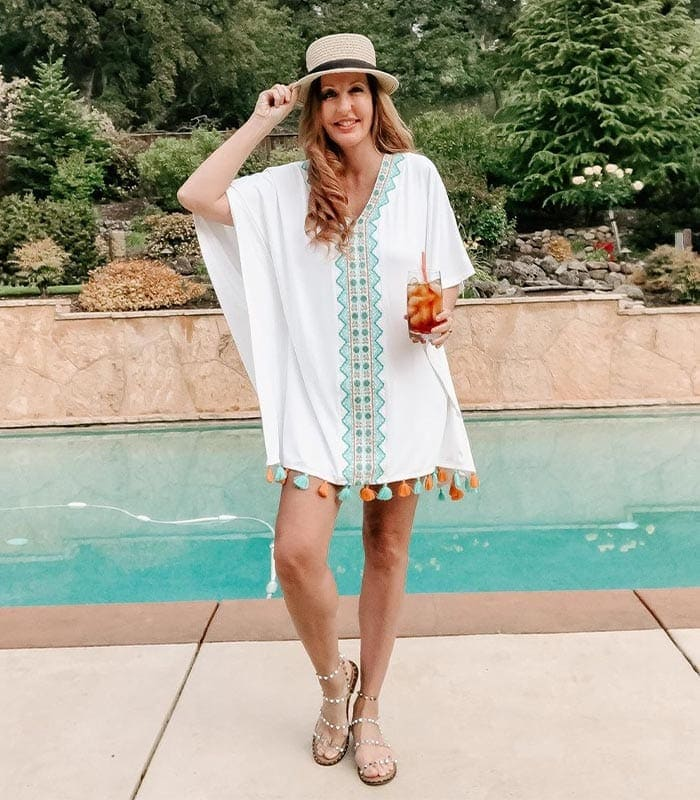 Hayley wears a short beach cover up | 40plusstyle.com