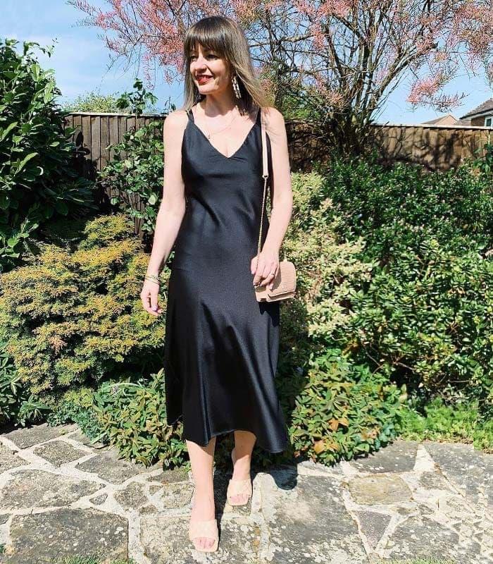Perfect little black dress - Lizzi wears a black slip dress | 40plusstyle.com