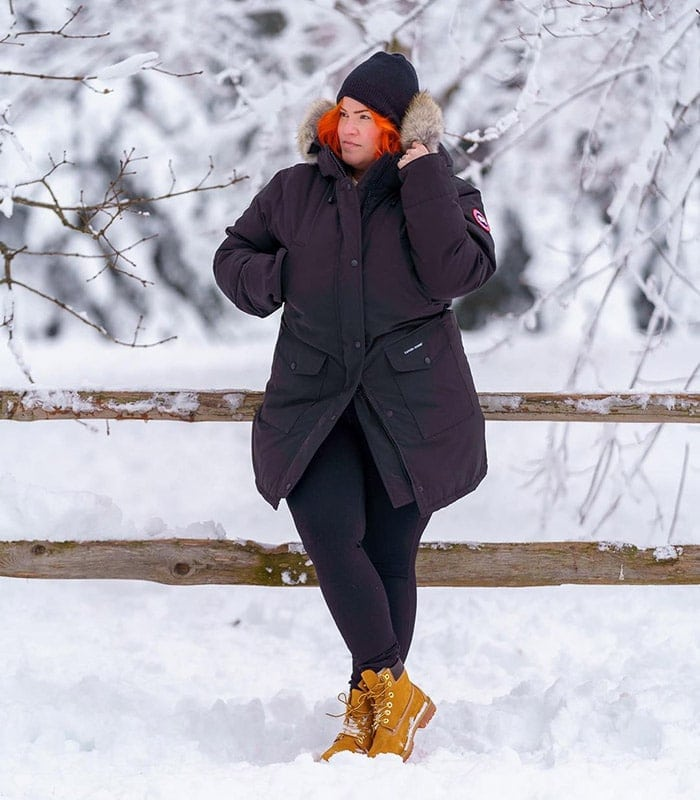 Hiking outfits for women - Dawn wears a cozy coat and lace-up boots   40plusstyle.com