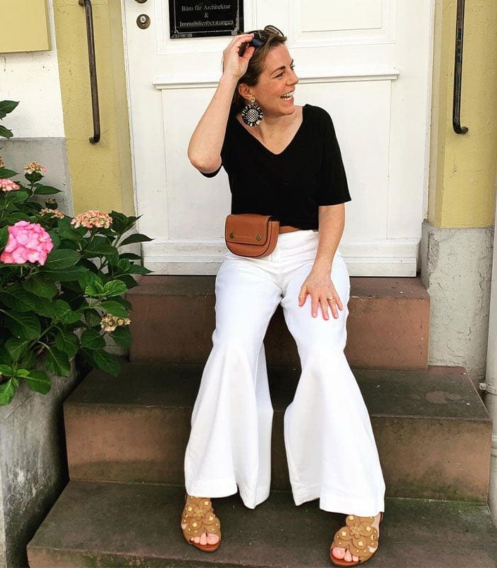 How to wear palazzo pants: your guide to putting together the best palazzo pants outfits | Sophie @stylemixers in black and white outfit | 40plusstyle.com