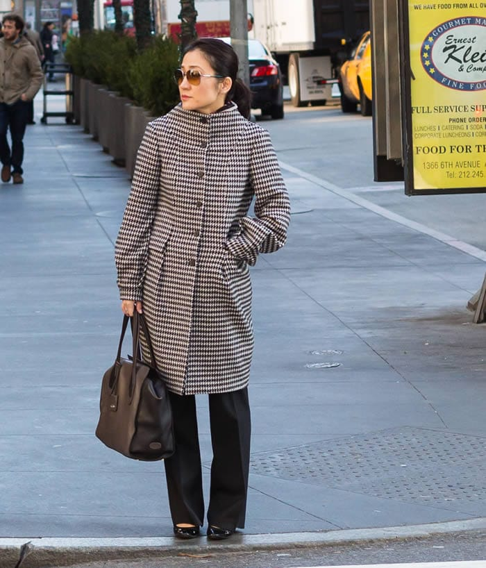 Getting noticed in a chic black and white coat | 40plusstyle.com