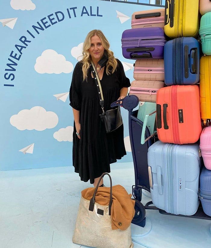 travel clothes for women - a loose black dress | 40plusstyle.com