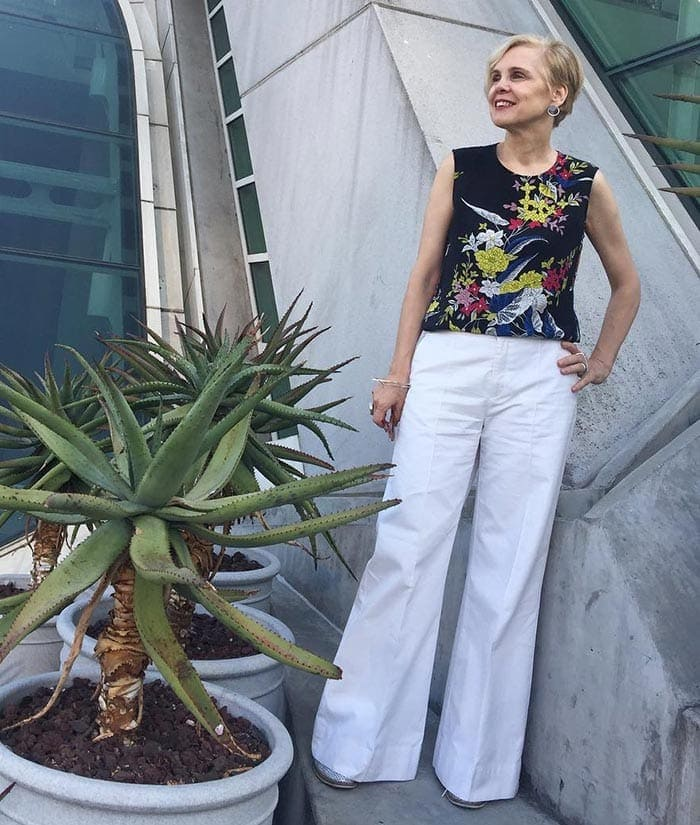 Sylvia in white jeans and a floral top | 40plusstyle.com