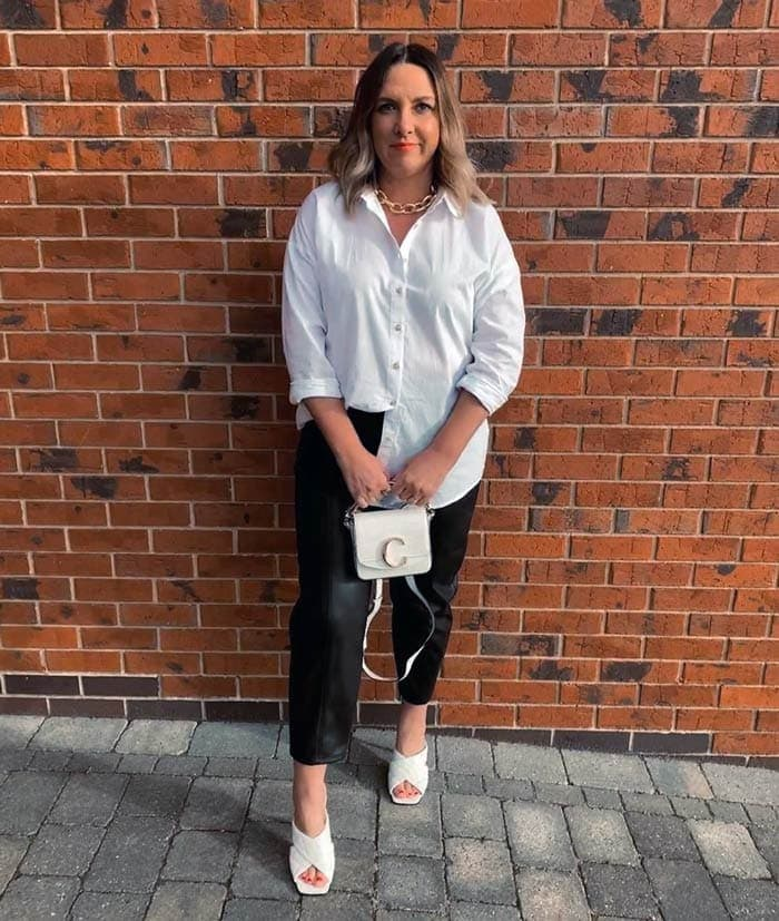 Bev wearing white mules with black pants | 40plusstyle.com