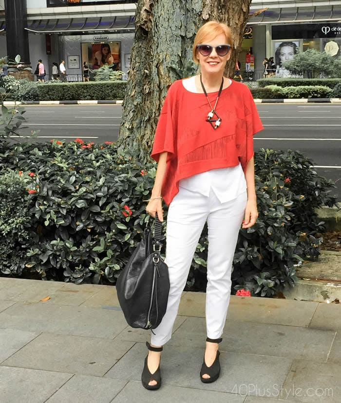 Wearing an asymmetrical top with white jeans | 40plusstyle.com