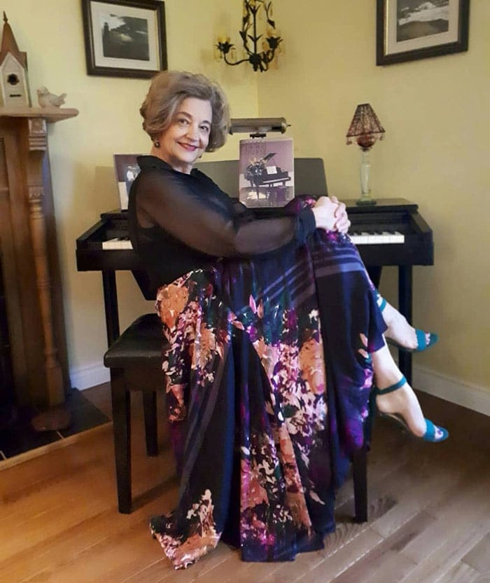 Terrie wearing black sheer blouse and printed maxi skirt | 40plusstyle.com