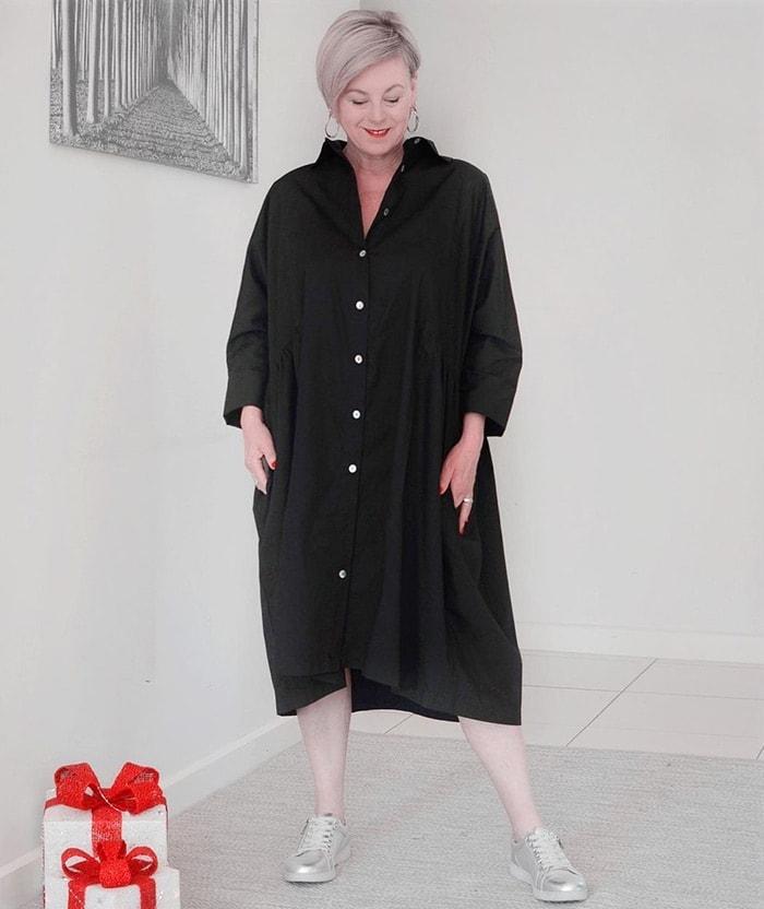 Deborah wears a black shirt dress | 40plusstyle.com