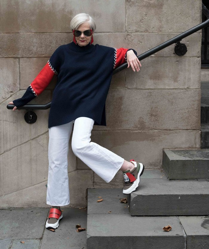 Accidenatal Icon Wearing Navy and Red Sweater | 40plusstyle.com