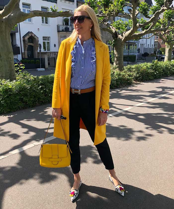 best coats for winter - Nadine in a yellow coat | 40plusstyle.com