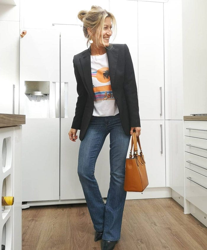 wearing a black blazer and bootcut jeans | 40plusstyle.com