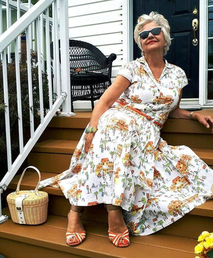 Terri in a print dress and sandals | 40plusstyle.com