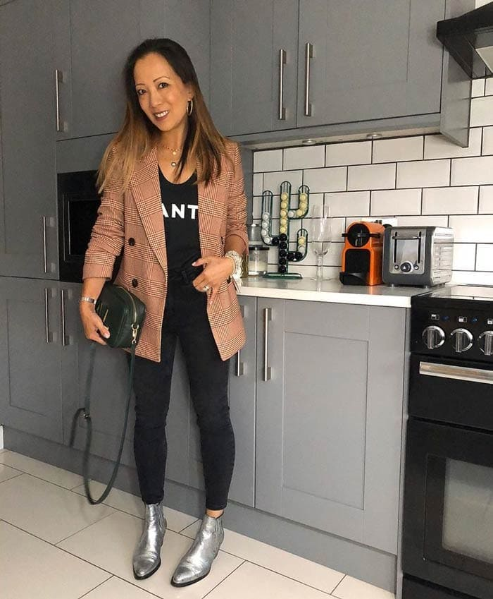 Abi wearing a blazer, tee, jeans and booties | 40plusstyle.com