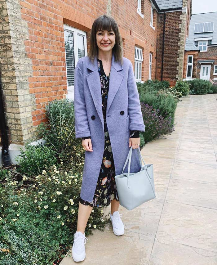 straight coats for women - Lizzi wears a gray double-breasted style | 40plusstyle.com