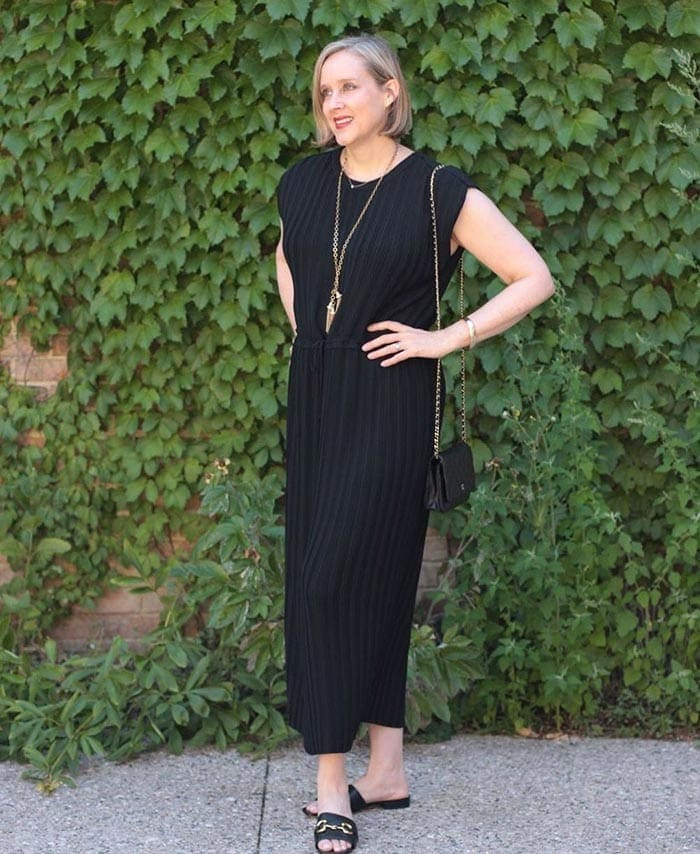 Ashley in a black dress with long necklace | 40plusstyle.com