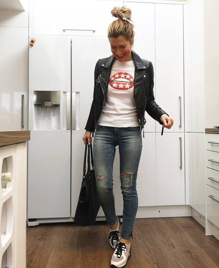 Abi wearing a moto jacket and jeans | 40plusstyle.com