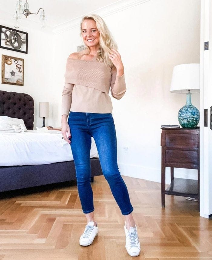 Winter sweaters for women - Erin wears an off-the-shoulder sweater | 40plusstyle.com