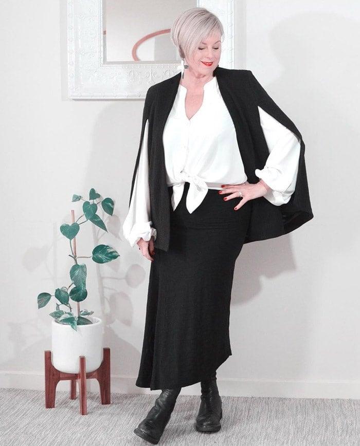 Deborah wearing an on-trend cape style coat | 40plusstyle.com
