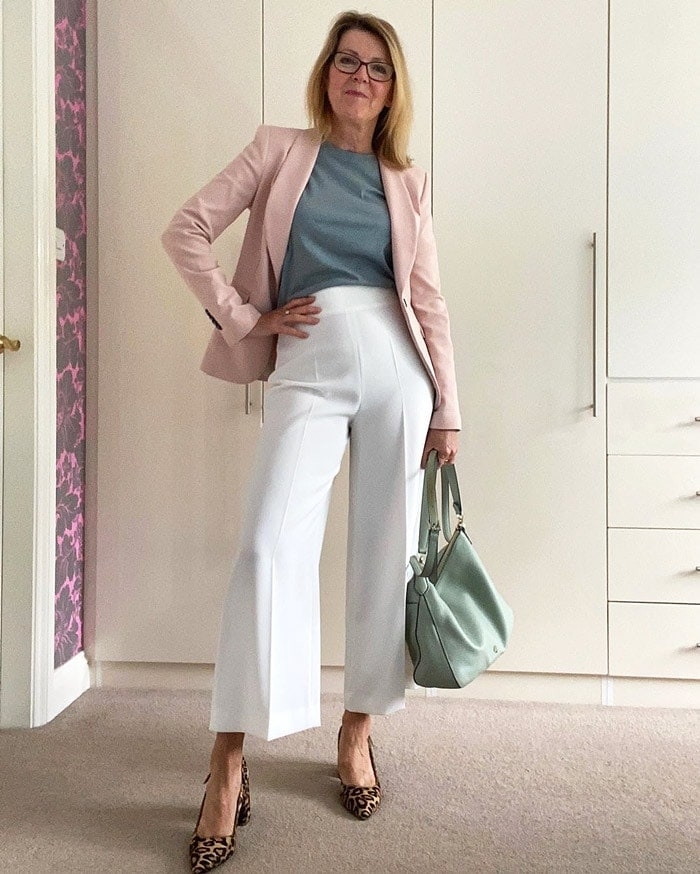 Wearing a pair of flared pants for a classic, timeless look | 40plusstyle.com