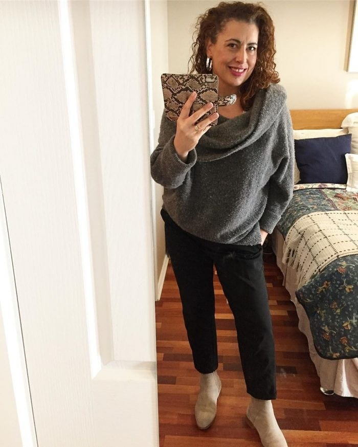 Fee wears black pants and a cowl neck sweater | 40plusstyle.com