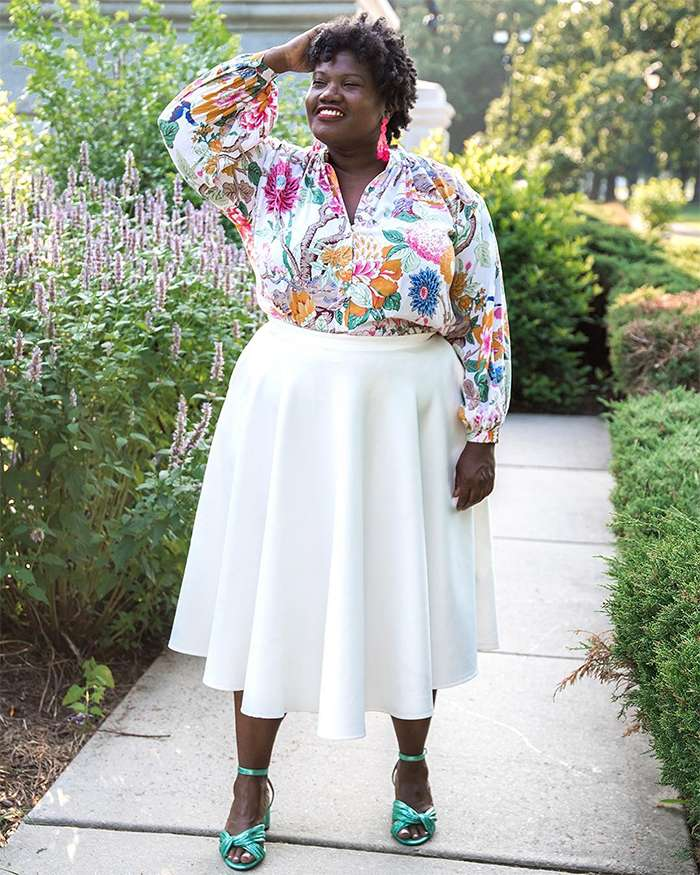 Georgette from Grown and Curvy Women is wearing Floral Long Sleeve Blouse with White Skirt and Green Strap Sandals | fashion over 40 | 40plusstyle