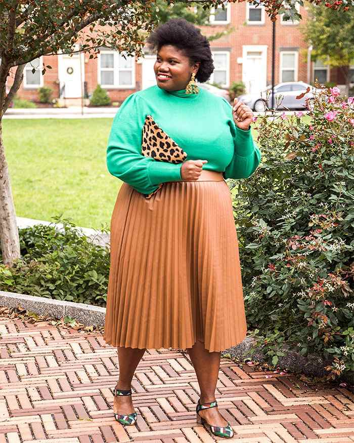 Georgette from Grown and Curvy Women is wearing Green Sweatshirt with Nude Pleated Skirt and Leopard skin Bag | fashion over 40 | 40plusstyle
