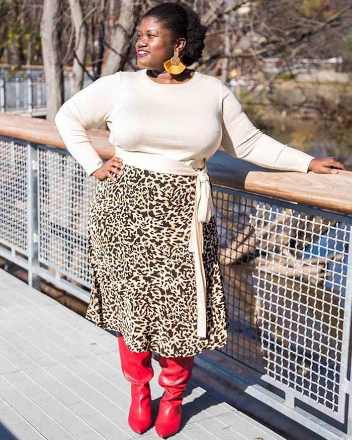 Georgette from Grown and Curvy Women is wearing Wrap Top with Leopard Print Skirt and Red Boots | fashion over 40 | 40plusstyle