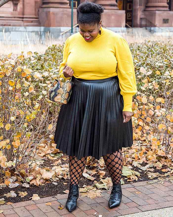 Georgette from Grown and Curvy Women is wearing Yellow Sweatshirt and Black Pleated Skirt with Snakeskin Bag Yellow Sweatshirt and Black Pleated Skirt with Snakeskin Bag | fashion over 40 | 40plusstyle