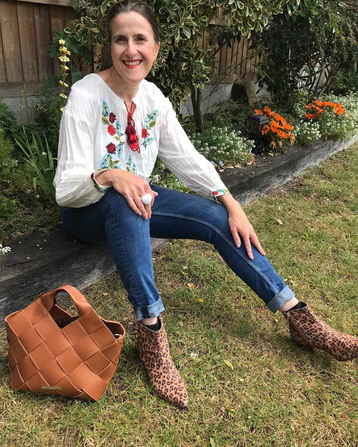 boho look inspiration: embroidered peasant top, jeans and booties | 40plusstyle.com