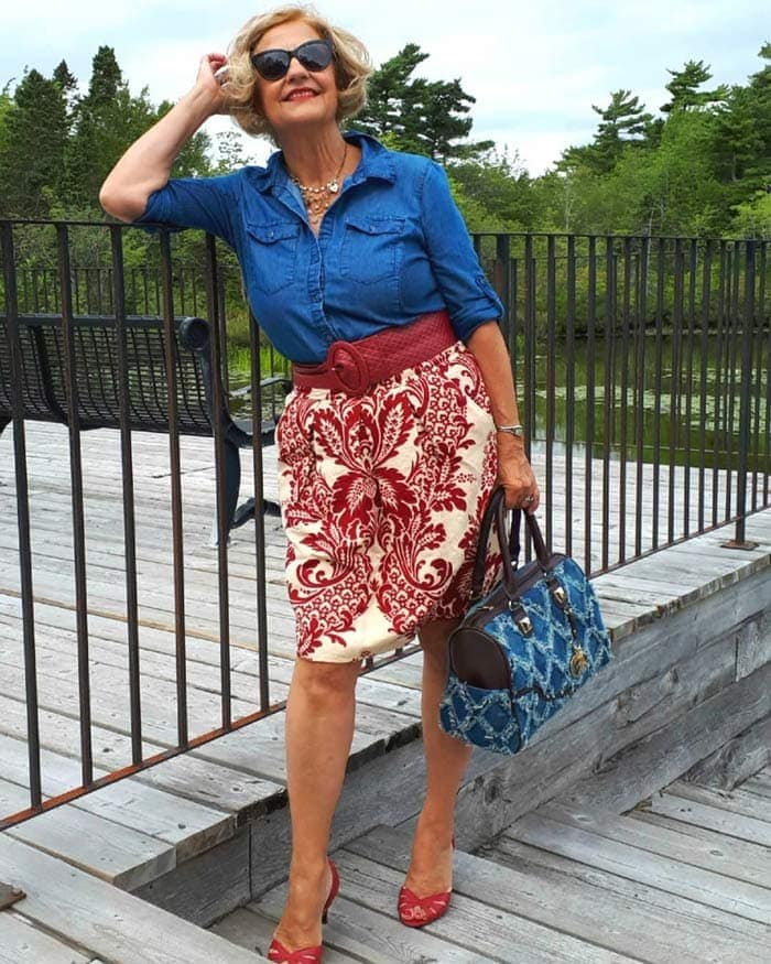 Terrie wearing a button down top, pencil skirt and belt | 40plusstyle.com