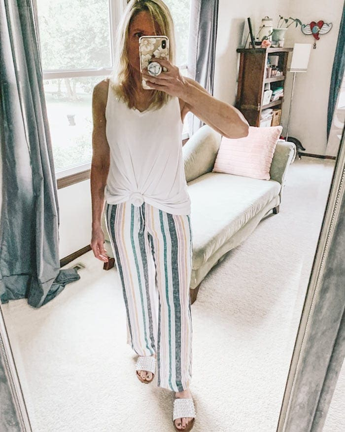 loungewear outfit featuring striped drawstring pants and a knotted tank   40plusstyle.com