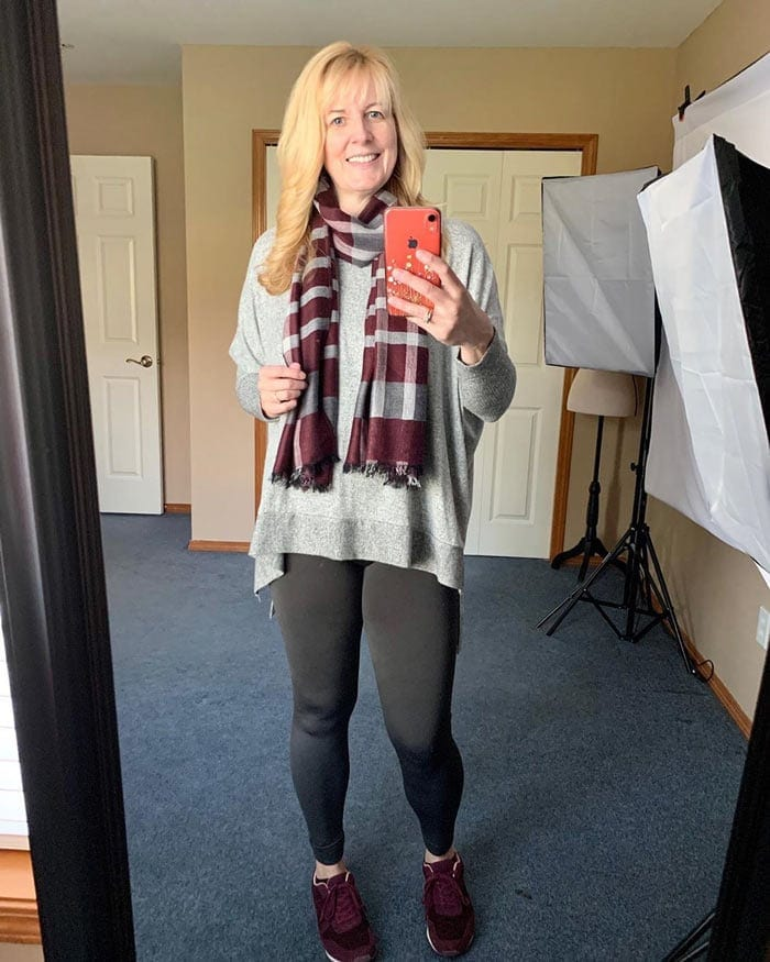 a loungewear outfit with burgundy scarf and sneakers   40plusstyle.com