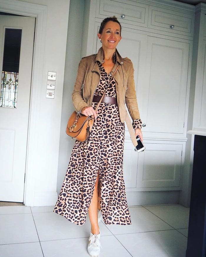 Karen wears a moto jacket with an animal print maxi dress | 40plusstyle.com