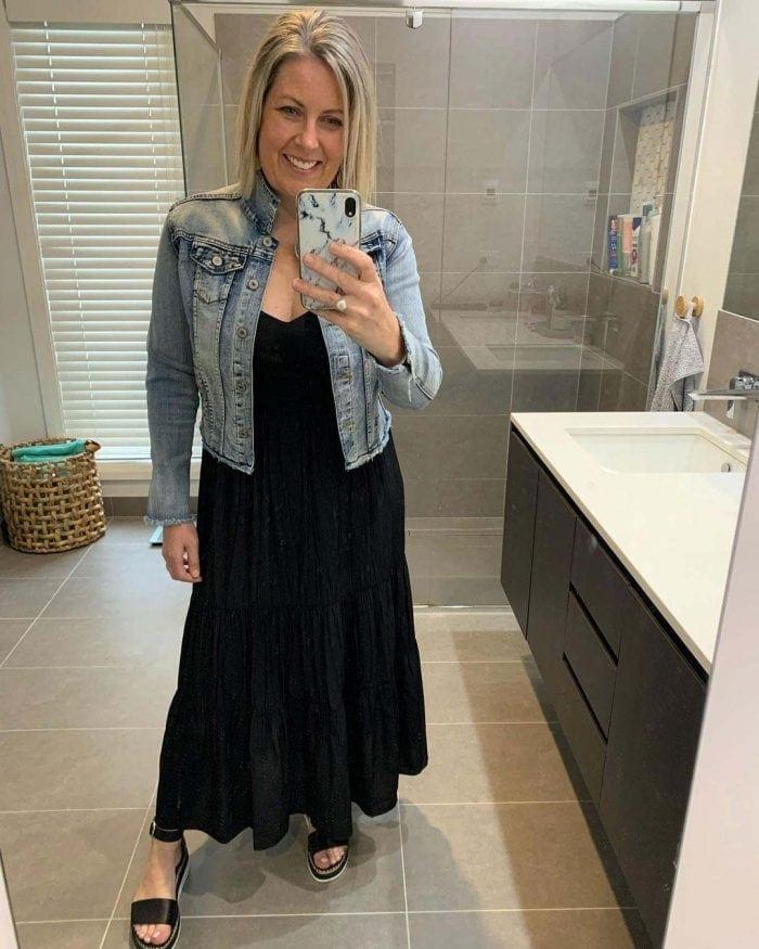 Beth wears her black dress with a denim jacket | 40plusstyle.com
