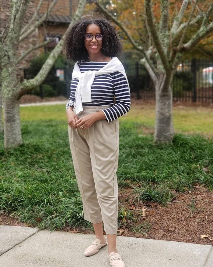 Mo wearing a striped top, pants and mules | 40plusstyle.com